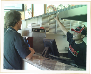 One of our top-selling Ameci's franchises, with one of our friendly employees helping a customer with an order.