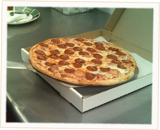 An Ameci's Pepperoni Pizza, fresh out of the oven and into the box.
