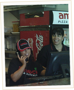 Our Ameci's Team Members taking orders over the phone for our customers.