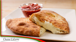 A Calzone with a side of marinara sauce